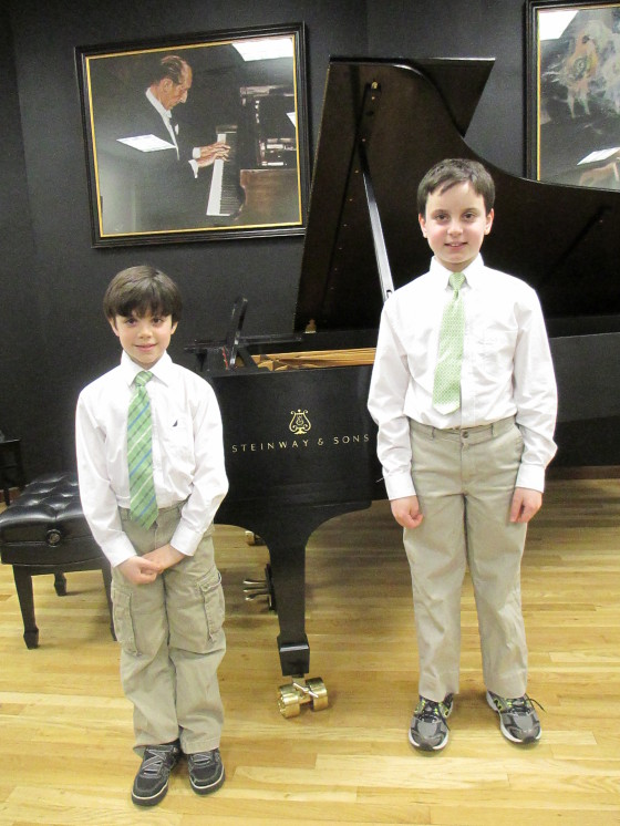 James (left) and Daniel, after they got the thrill of playing a $150,000 Steinway grand at their last recital.