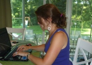 "Me at work last summer, in my ""summer office,"" aka the kitchen."